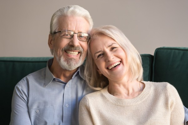 older couple leaning on each other and smiling